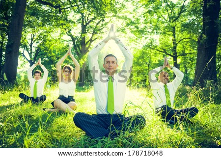 Business People Doing Yoga in Green Forest