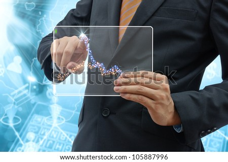 Business people drawing a graph by finger on glass tablet touch screen.