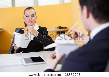 Business people eating Chinese food during lunch break in the office