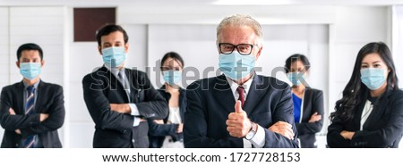 Business people , employees and office worker wearing ppe face mask while standing in reopen office . Concept of business reopen by people work with face mask wearing for protection .