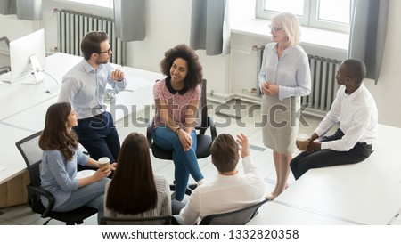 Business people employees group discussing work plan with coach mentor at corporate office meeting, multicultural workers sales team talking at company workshop training, top view overhead from above