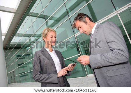 Business people exchanging phone numbers
