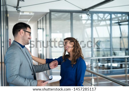 Business people flirting on job. Manager seducing an attractive sexy woman. Man hitting on pretty brunette. #1457285117