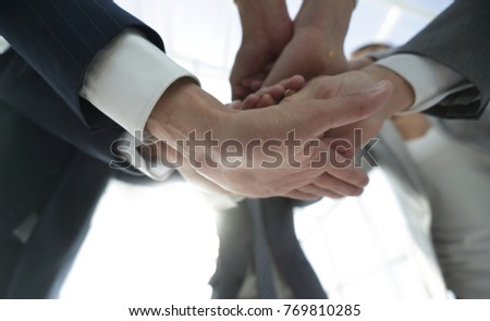 business people folding their hands together. #769810285