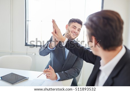 Business people giving High Five in teamwork