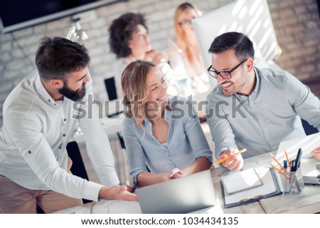 Business people giving some new ideas about project to his partners in conference room.