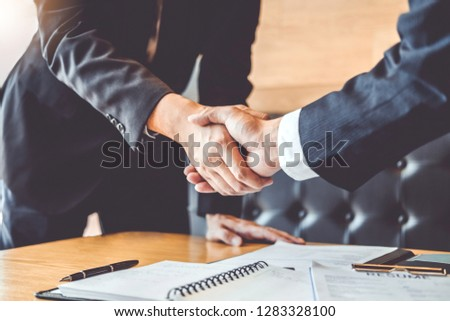 Business people greeting new colleagues while job interviewing shaking hands meeting Planning after during job interview Concept