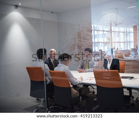 business people group brainstorming on meeting and businessman presenting ideas and projects oon laptop and tablet computer #419213323