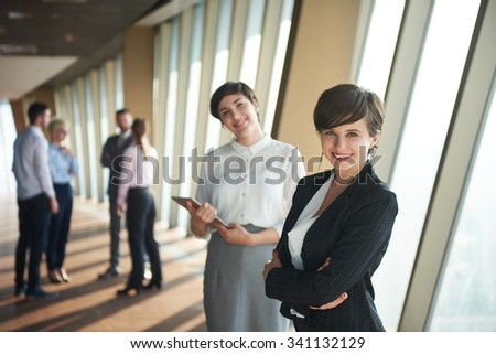business people group,  females as team leaders standing together  in modern bright office interior #341132129