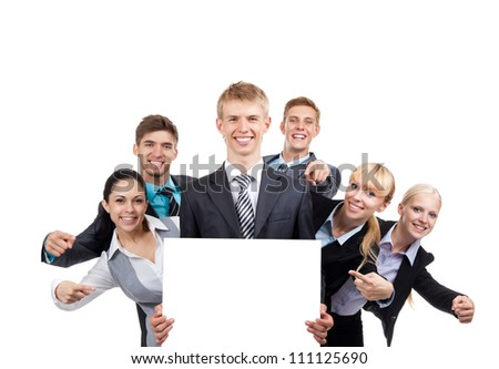 Business people group holding blank white card board, signboard, point finger showing an empty bill board, young businesspeople standing together happy smile, portrait Isolated over white background