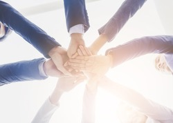 business people group join hands Support Together. ,friendship and teamwork Concept