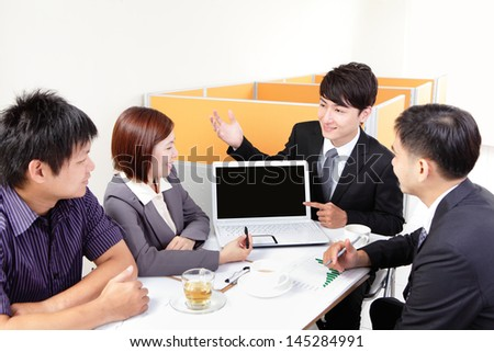 business people group meeting with finger point empty computer screen ( copy space ) at office, asian people