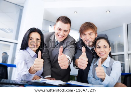 Business people group team hold point thumb up finger gesture at you, Successful excited young businesspeople happy smile at office desk