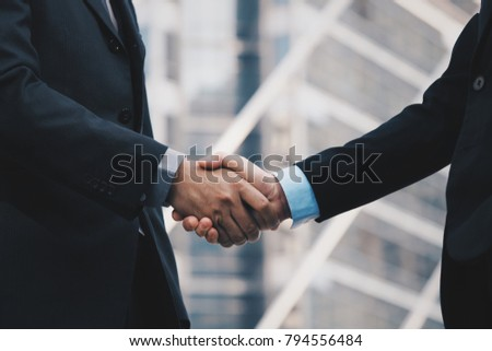 Business people hand concept teamwork on city background