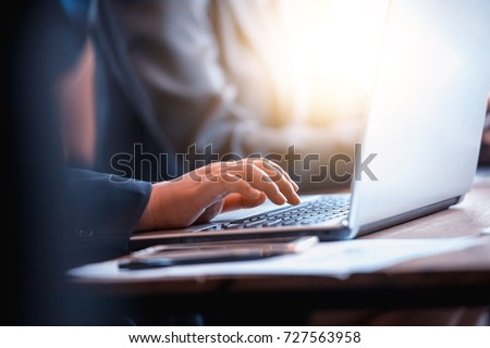 business people hand typing on...