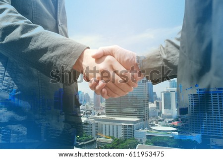 Business People Handshake Greeting Deal Concept, modern city background. - Shutterstock ID 611953475