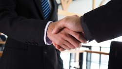 Business people handshake partnership successful meeting concept, blurred focus for background