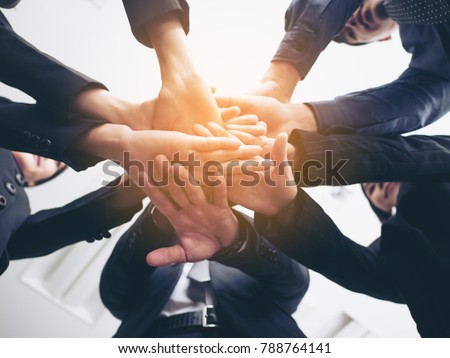 Business people handshaking. People with business team stacking hands together. Vintage tone. #788764141