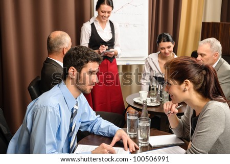 Business people have company meeting at restaurant waitress ordering