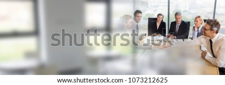Photo of  Business people having a meeting with windows transition effect