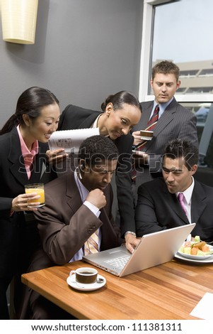 Business people having discussion during their break