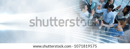 Photo of  Business people having fun celebration party with fluid lines transition