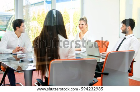 Business people having meeting in conference room. View through the glass. - Shutterstock ID 594232985