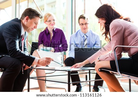 Business people having meeting or workshop in office