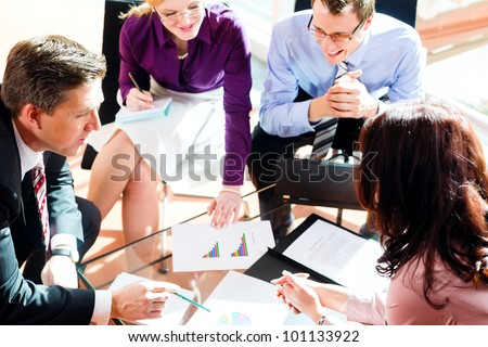 Business people having meeting or workshop in office checking profit growth graph and documents