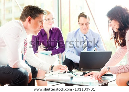 Business people having meeting or workshop in office profit growth graph and documents