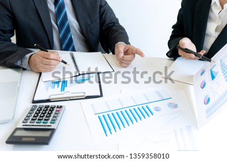 Business people Having Meeting with Project managers meeting. man and woman discussion document in the office.collaborative filtering  Analyze plans #1359358010