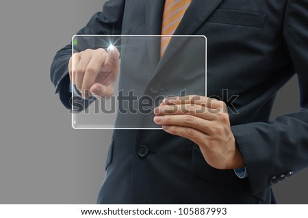 Business people holding finger on glass tablet touch screen.