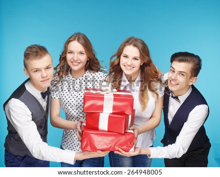 Business people holding red gift boxes. Female and male model studio posing. Hipster Style