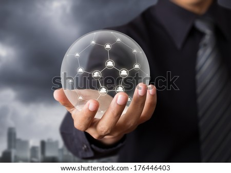 Business people holding social network in crystal ball #176446403