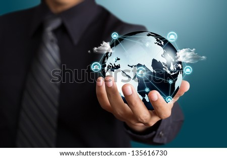 Business people holding social network with globe