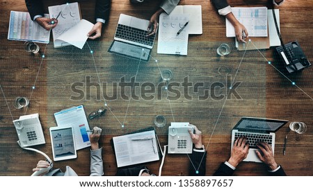 Business people in a stock market meeting #1358897657