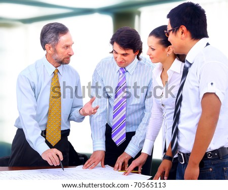 Business people in a work meeting in the office - stock photo