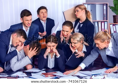 Business people in crisis into office. Team people are unhappy sitting table and working papers. Cabinets with folders and jalousie background. Expenses exceed income for year concept