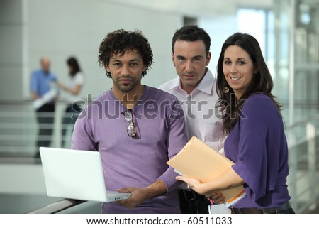 Business people in front of a laptop computer