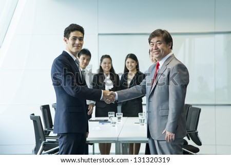Business people in meeting room.