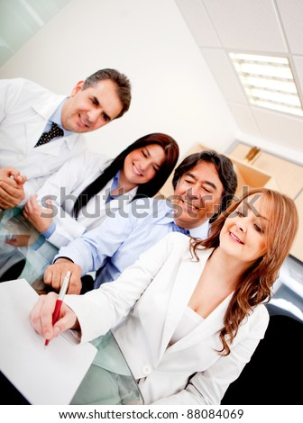 Business people in meeting with doctors signing a contract on medical insurance