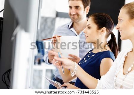 Business people in modern office - Shutterstock ID 731443525