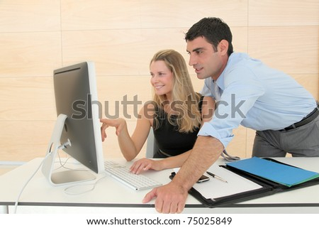 Business people in office working on computer