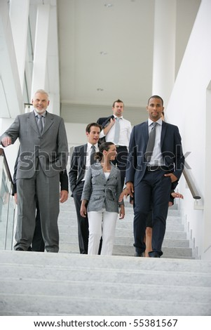 Business people in suit coming down stairs