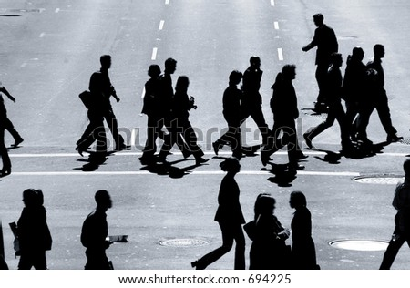 Business people in the cross walk. - stock photo