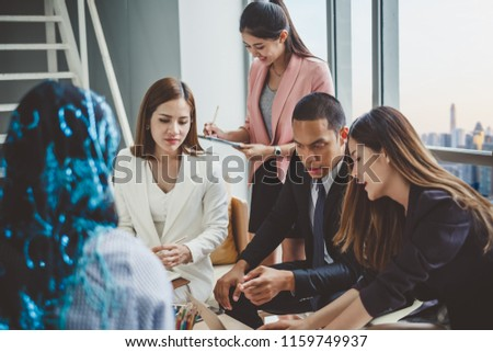 Business people in the meeting room discussing about financial report on desk/table in office #1159749937