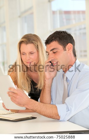 Business people in the office with electronic tablet