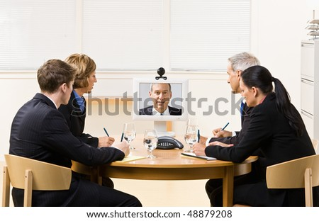 Business people in video meeting - stock photo