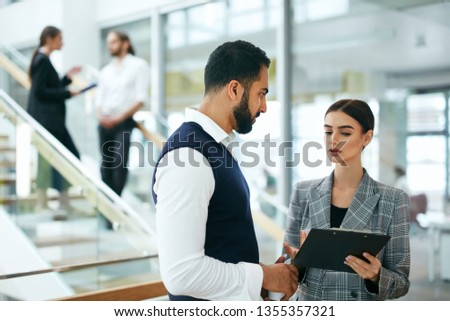 Business People In Working Environment. Team Of Man And Woman Working In Business Office Center. High Resolution #1355357321