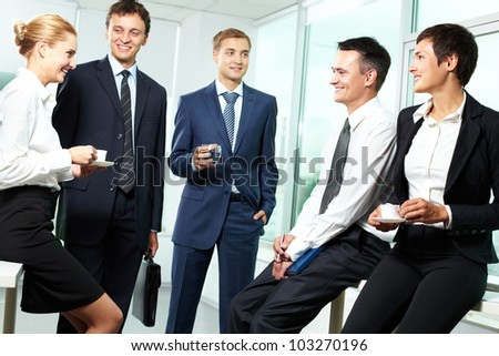 Business people interacting with each other in semi-formal situation